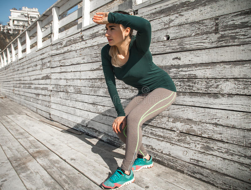 Fitness sporty girl resting after exercising royalty free stock photo