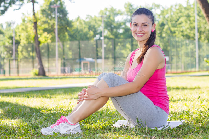 Fitness, Sporty ,Healthy Lifestyle , Smiling Female Relaxing stock photography