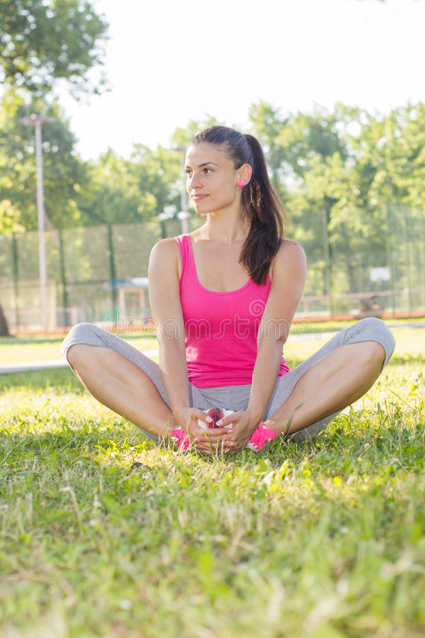 Fitness, Sporty ,Healthy Lifestyle , Smiling Female Relaxing. At beautiful summer day in the park stock photos