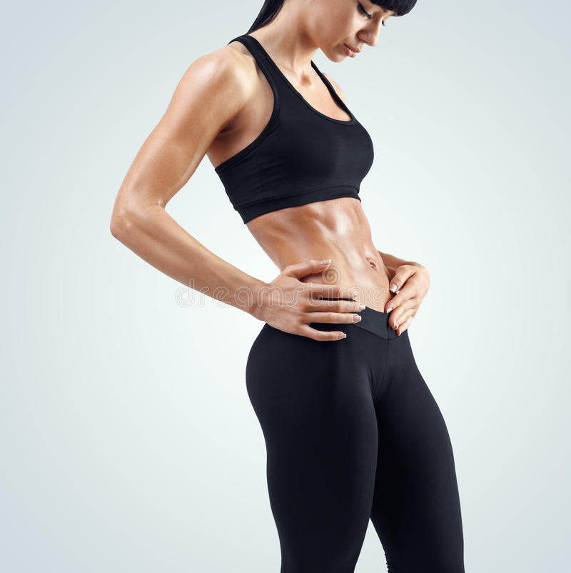 Fitness sporty woman showing her well trained body royalty free stock photography