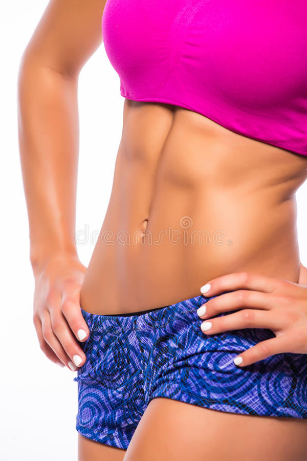 Fitness sporty woman showing her well trained body. royalty free stock photos