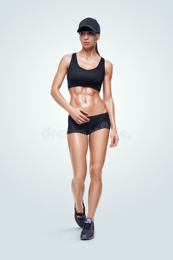Fitness sporty woman walking on white background royalty free stock photography