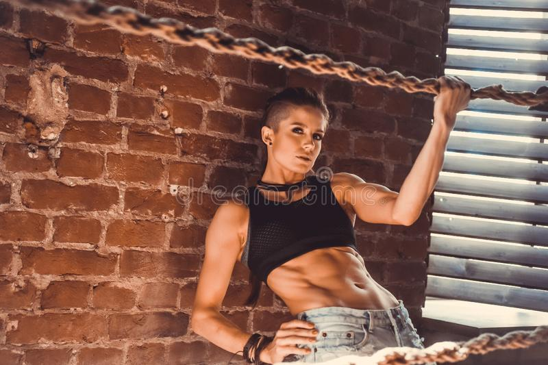 Fitness strength training workout concept - muscular bodybuilder sport girl doing exercises in gym. Fitness strength training workout concept background royalty free stock photography