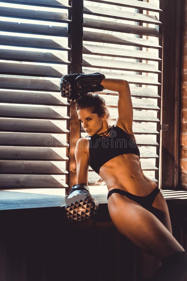 Fitness strength training workout concept - muscular bodybuilder sport girl doing exercises in gym. Fitness strength training workout concept background royalty free stock photo