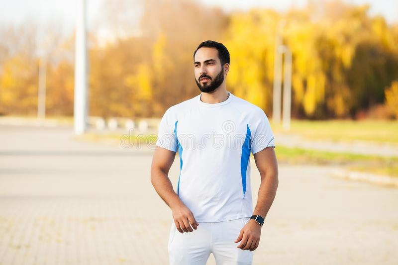Fitness. Stretch man doing stretching exercise. Standing forward bend stretches of legs royalty free stock photos