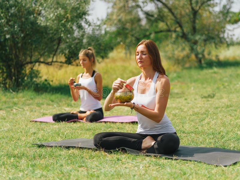 Fitness team are exercising in the park. Yoga concept. stock photos