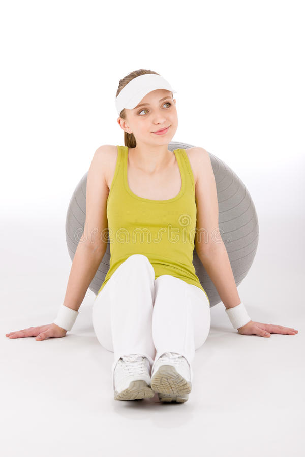 Fitness teenager woman in sportive outfit royalty free stock photo