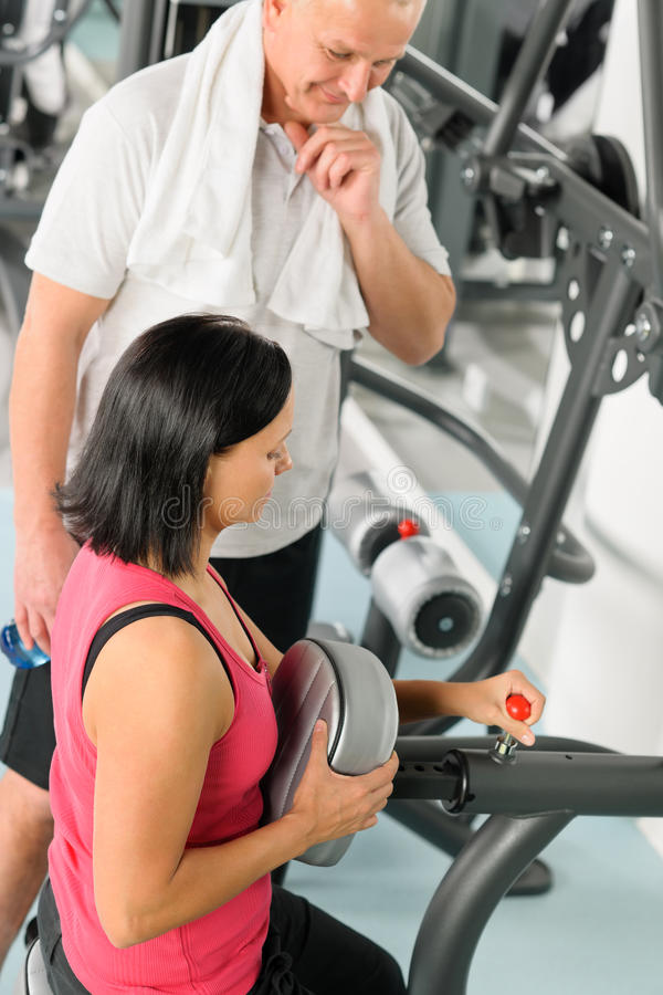 Free Fitness Trainer Adjust Machine Active Man Exercise Stock Photo - 23867550