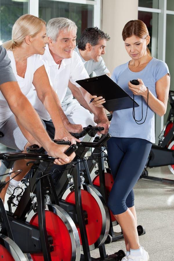 Fitness Trainer Coaching Senior Stock Photo