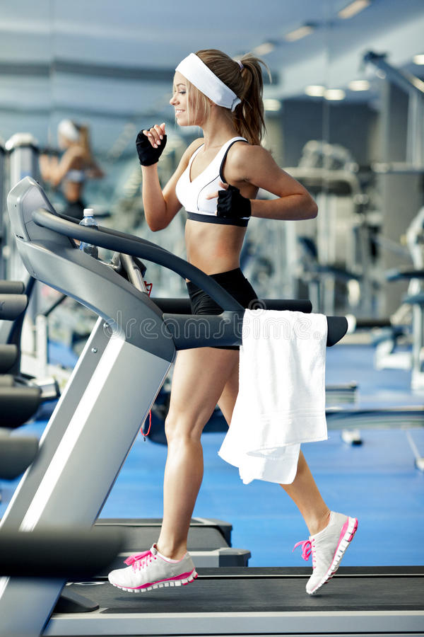 Download Fitness on a treadmill stock photo. Image of female, jogging - 36925644