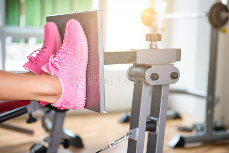 Fitness Unrecognizable young runner tying her shoelaces. Studio stock photo