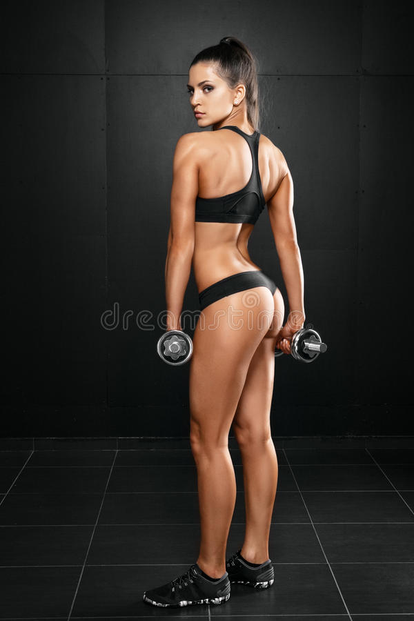 Fitness woman with barbells on grey background royalty free stock photo