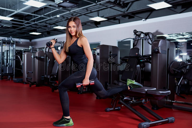 Fitness woman with barbells in gym. royalty free stock photos