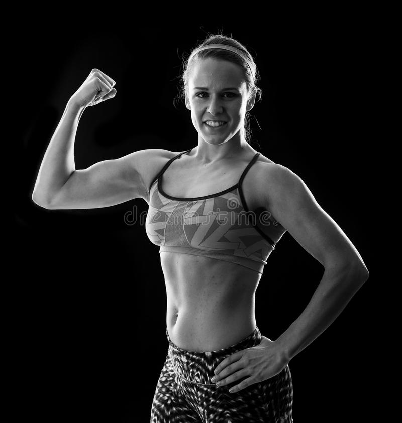 Fitness woman on black stock photos