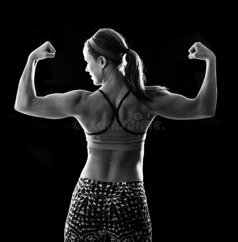 Fitness woman on black stock photography