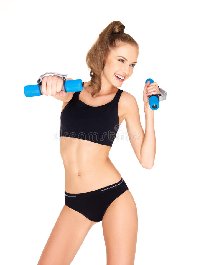 Fitness woman in black sports clothes. Isolated on white royalty free stock photo