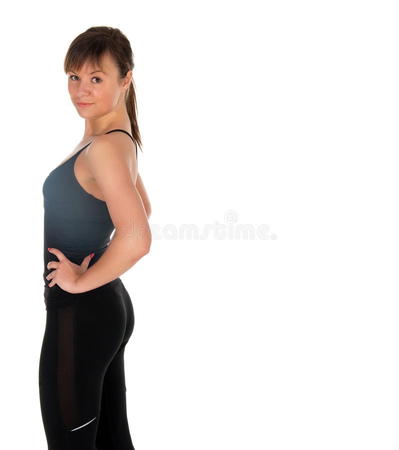 Fitness woman in black sports clothes isolated on white.  royalty free stock photo