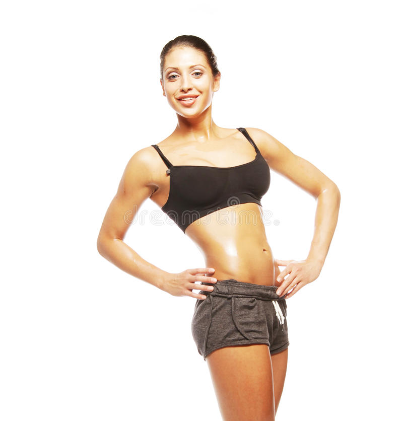 Fitness woman in black sports clothes. Isolated on white royalty free stock photography