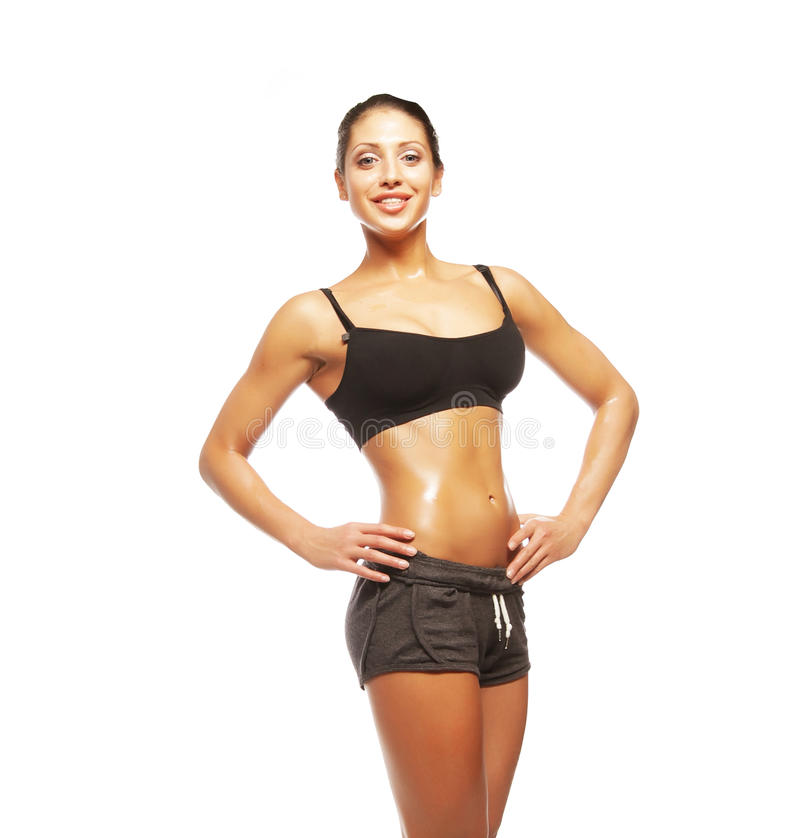 Fitness woman in black sports clothes. Isolated on white stock images
