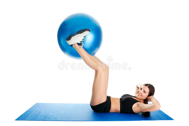 Fitness woman doing crunches on gym mat stock photo