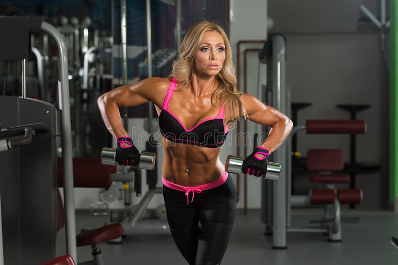 Fitness Woman Doing Exercise For Back With Dumbbells stock image