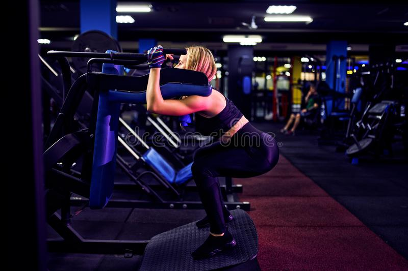 Fitness woman doing lunges exercises for leg muscle workout training in gym stock photos
