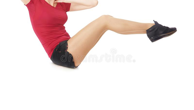 Fitness woman doing sit-ups exercise stock images