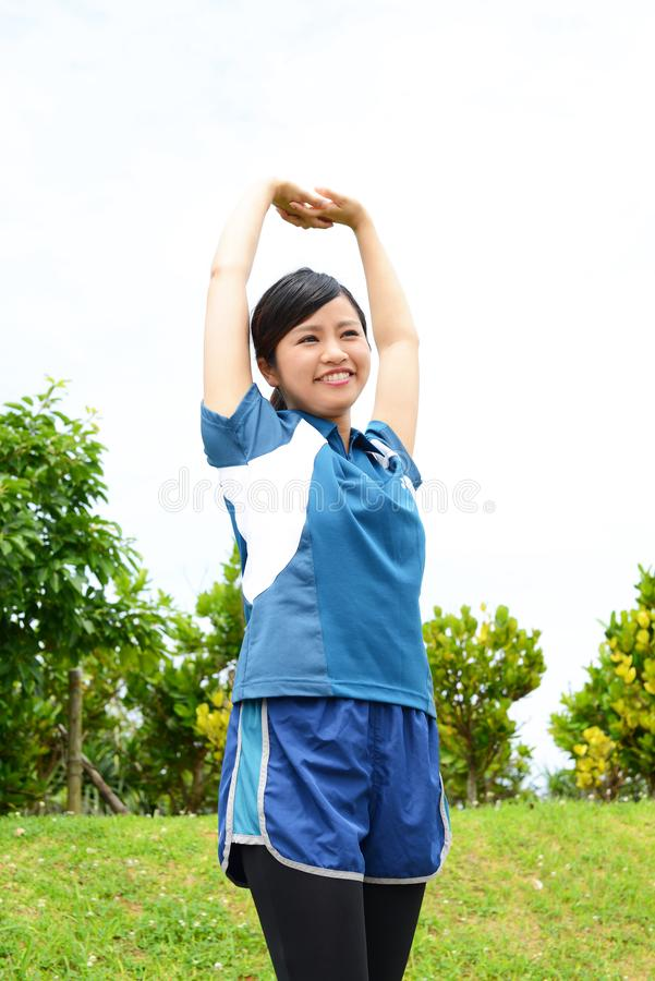 Fitness woman doing stretching exercise. Young woman relaxing at the park royalty free stock images