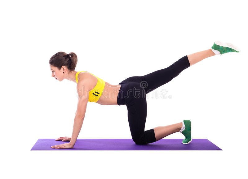 Fitness woman doing stretching exercises on foam pad royalty free stock photography