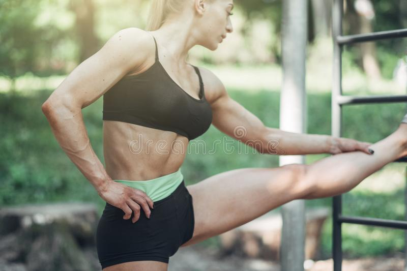 Fitness Woman Doing Training Workout Outdoor in Summer Morning Park. Concept Sport Healthy Lifestyle. stock photo