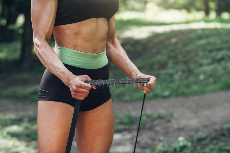 Fitness Woman Doing Training Workout Outdoor in Summer Morning Park. Concept Sport Healthy Lifestyle. Fitness Woman Doing Training Workout Outdoor in Summer stock photos