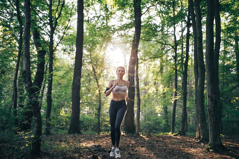 Fitness woman doing during workout stock photography