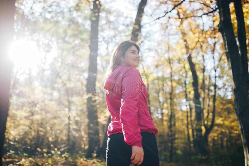 Fitness woman doing during workout in autumn forest royalty free stock photo