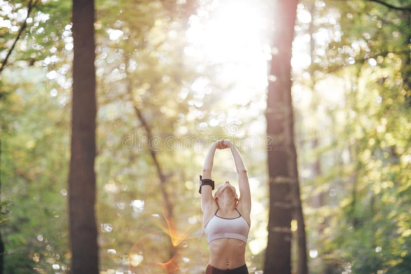 Fitness woman doing during workout. Healthy lifestyle stock photo