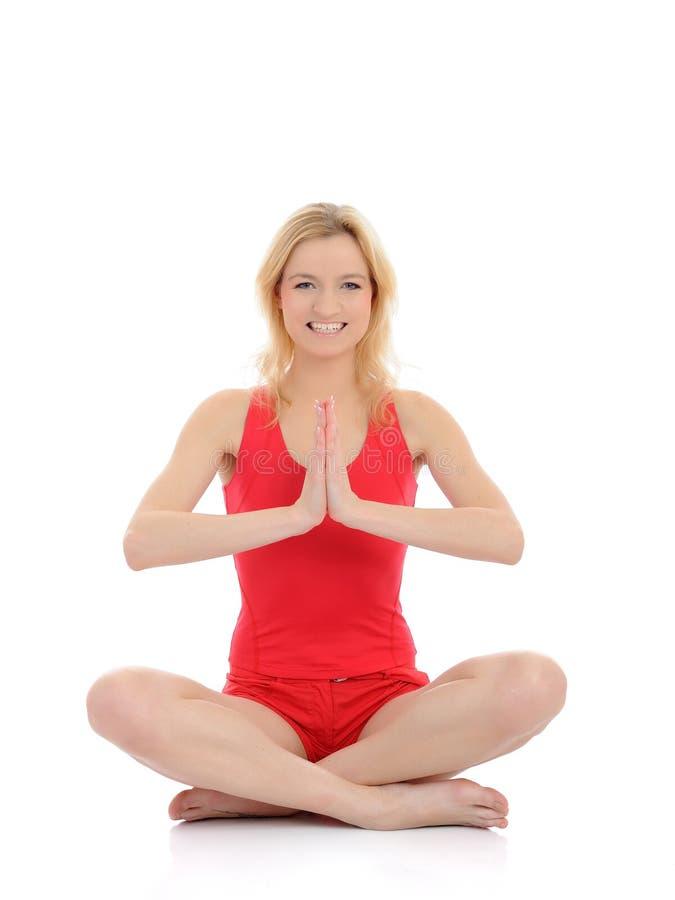 Fitness woman doing yoga meditation pose