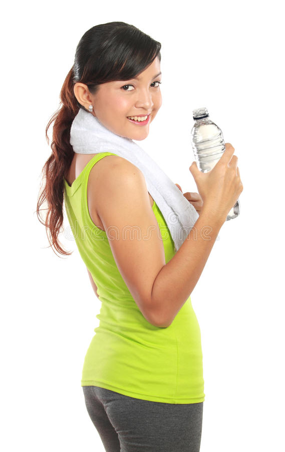 Fitness woman drinking water royalty free stock images