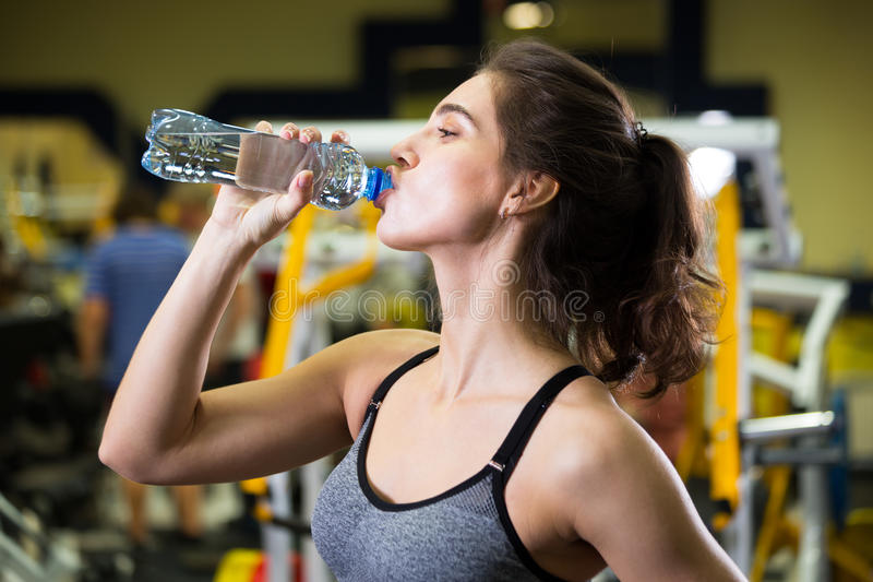 Download Fitness Woman Drinking Water From Bottle. Stock Photo - Image: 83705665