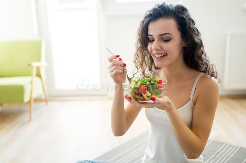 Fitness woman eating healthy food after workout stock image
