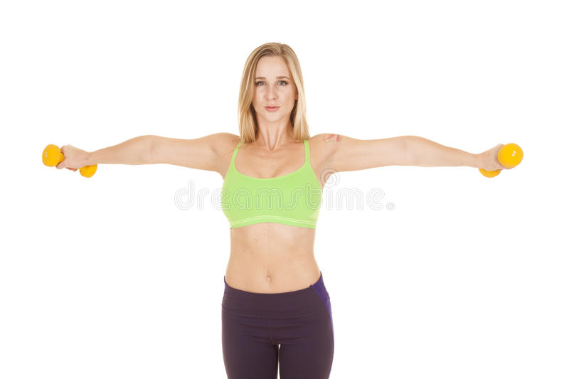 Fitness woman green bra weights out stock image