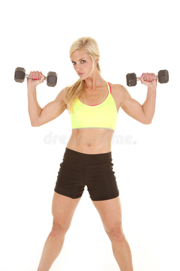 Fitness woman green sports bra weights up royalty free stock photo