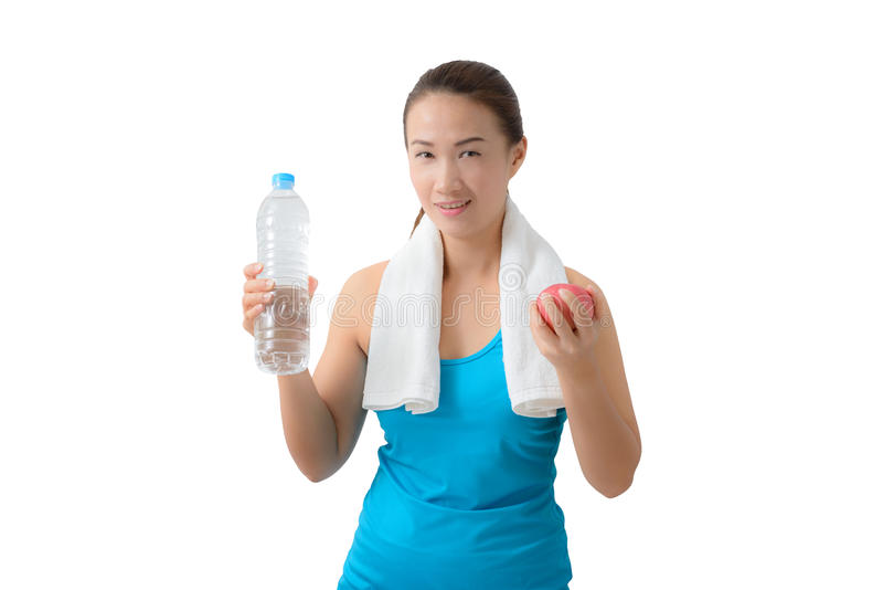 Fitness woman happy smiling holding apple and water bottle stock images