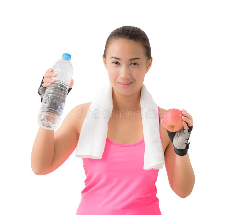 Fitness woman happy smiling holding apple and water bottle stock photo