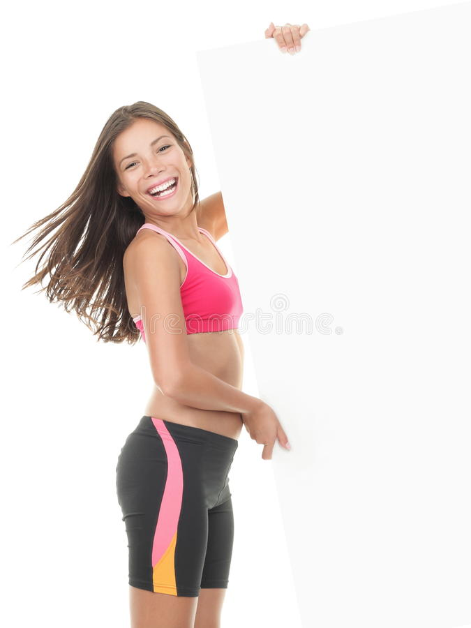 Fitness woman holding sign stock photos