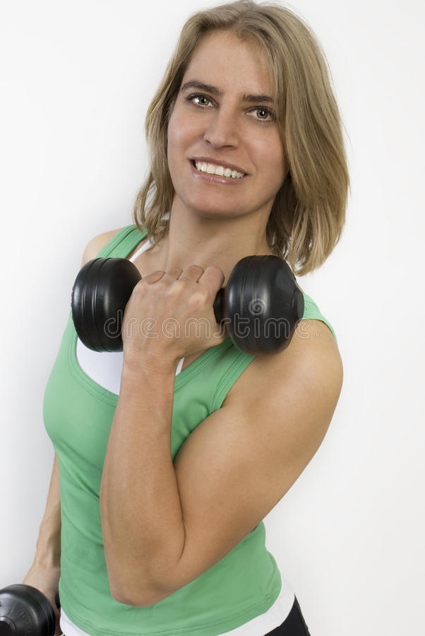 Fitness woman holding weights in her hands. royalty free stock image