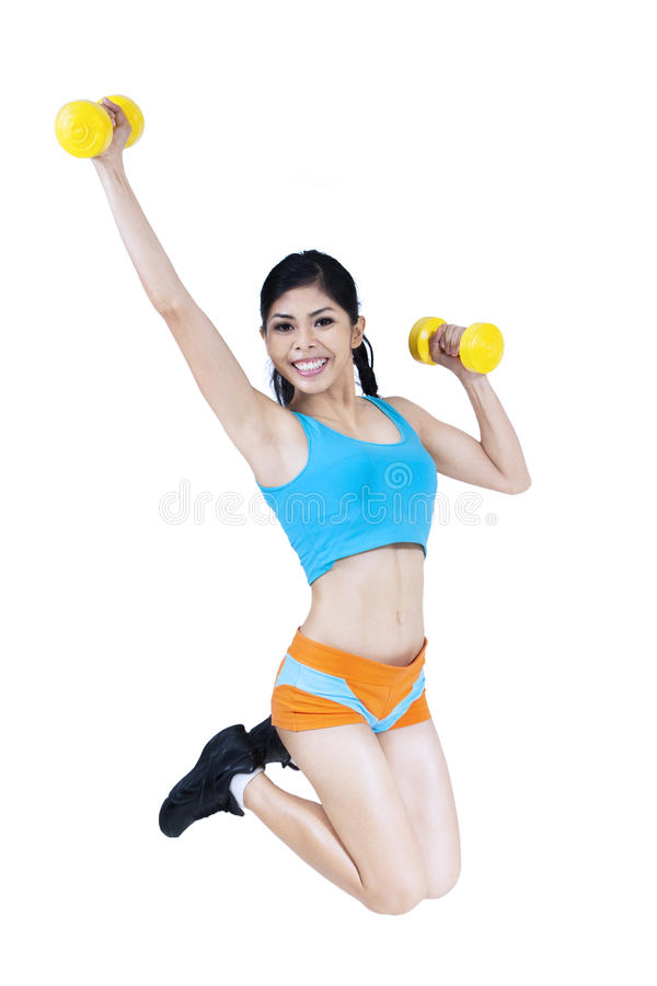 Download Fitness Woman Jumping With Dumbbell Stock Image - Image of adult, dumbbell: 33654781