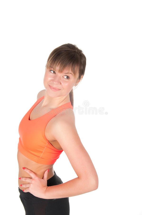 Fitness woman in orange sports clothes isolated on white.  stock images