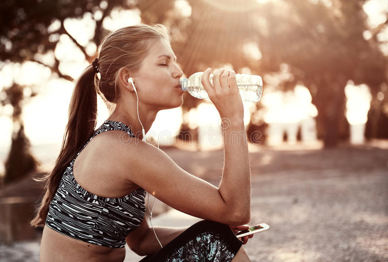 Fitness woman outdoors royalty free stock images
