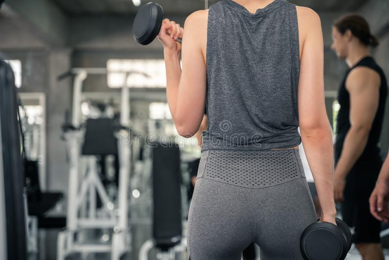 Fitness woman with personal trainer at gym royalty free stock images