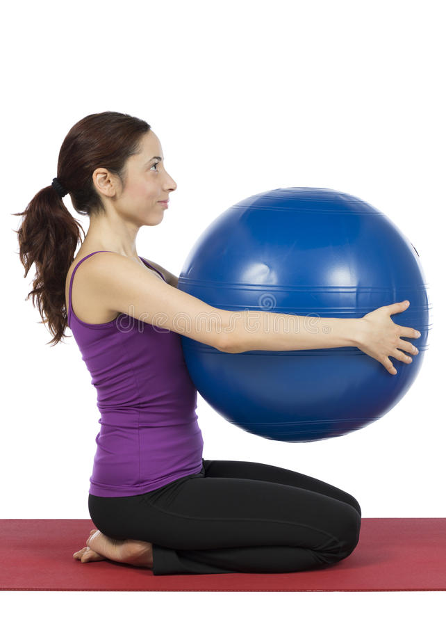 Fitness woman with a pilates ball, vertical stock photos