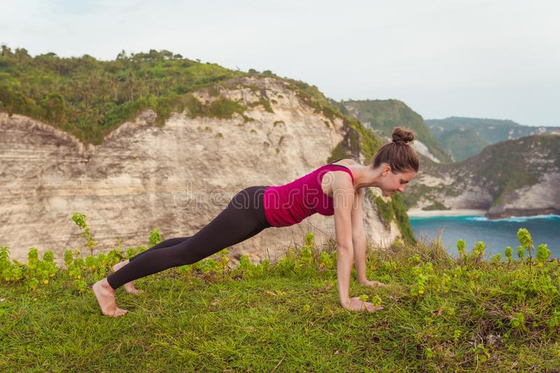 Fitness woman doing yoga exercises. Girl training plank pose. royalty free stock images